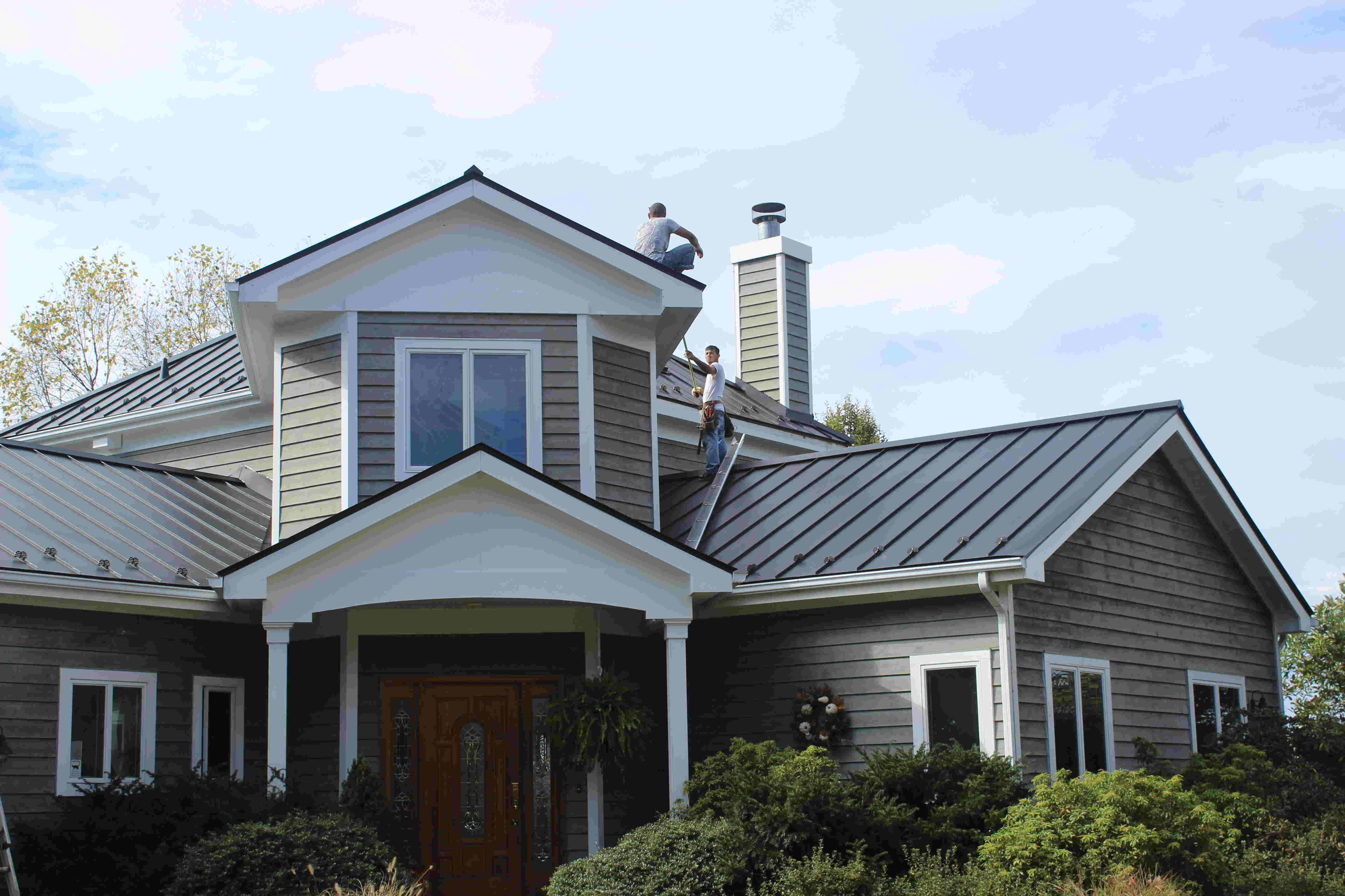 Leesburg metal roof installation for Black roof house